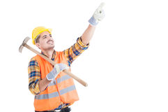 Portrait of happy engineer pointing up and holding shovel Stock Images