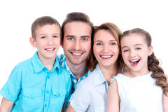 Portrait of the happy european family with children. Looking at camera - isolated on white background royalty free stock photography