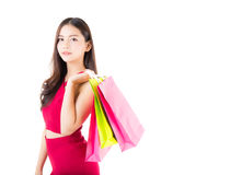 portrait of a happy excited asian woman in red dress standing and shopping bags. Stock Photos