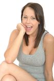Portrait of a Happy Excited Pleased Attractive Young Woman Smiling Stock Photo
