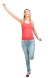 Portrait of happy excited woman. Full length portrait of happy excited  young woman jumping with arms extended . Over white background Royalty Free Stock Image