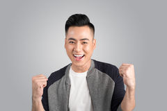 A portrait of happy excited young asian man with success positiv. E emotions Stock Photo