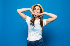 Close up portrait of a happy excited young woman in beach hat happy looking at camera isolated over blue background. Portrait of a happy excited young woman in Royalty Free Stock Photo