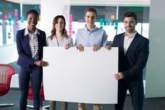 Portrait happy executives holding a blank banner. In office royalty free stock photography