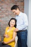 Portrait of happy expectant couple Stock Images