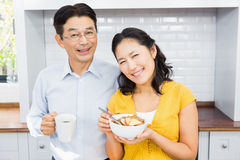 Portrait of happy expectant couple. In the kitchen in morning royalty free stock photography