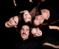Portrait of Happy Family with 5 Members. Family of 5 Portrait Lying Down in a Circle on Black stock photos