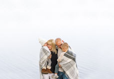 Portrait of a happy family against the background water Stock Photos