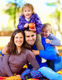 Portrait of happy family in autumn park Royalty Free Stock Photo