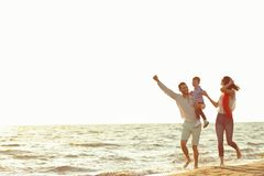 Portrait of happy family and baby enjoying sunset in the summer leisure.  royalty free stock photos