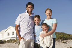 Portrait Of Happy Family On Beach Stock Photo