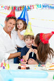 Portrait of a happy family during a birthday party. At home stock photography