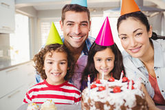 Portrait of happy family celebrating birthday. Close-up portrait of happy family celebrating birthday at home royalty free stock image