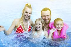 Happy family with children in the pool. Portrait of the happy family with children in the pool stock photography