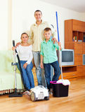 Portrait of happy family  with  cleaning equipment Stock Photos