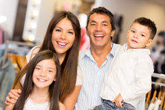 Happy family in a clothing store Royalty Free Stock Images