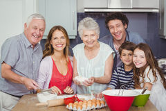 Portrait of happy family cooking food in kitchen Royalty Free Stock Images