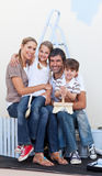 Portrait of a happy family decorating a room. After move in Royalty Free Stock Image
