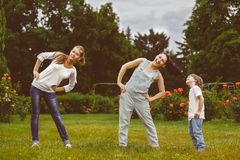 Portrait of happy family doing physical and sports stock image
