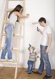 Portrait of happy family doing repair, new house Royalty Free Stock Images
