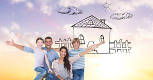 Portrait of happy family with dream house Stock Photos