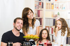 Portrait of happy family eating breakfast Royalty Free Stock Image