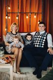 Portrait of happy family embracing in decorated studio. stock photography