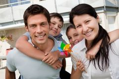 Portrait of happy family enjoying outdoors Stock Image