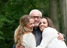 Portrait of a happy family with father and two daughters. Fun portrait of a happy family with father and two daughters Stock Image