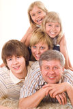 Portrait of a happy family of five. On a light background royalty free stock photos