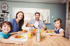 Portrait of happy family with food on dining table Stock Image