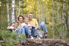 Portrait of happy family of four in autumn park royalty free stock photo