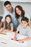 Portrait of a happy family of four in kitchen Royalty Free Stock Photo