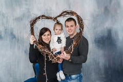 Portrait of a happy family in frame from heart. Love holiday. St. Valentine`s Day. Stock Photo