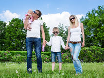 Portrait Of Happy Family In Garden Royalty Free Stock Photos