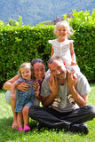 Portrait of happy family on the green lawn Royalty Free Stock Images