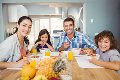 Portrait of happy family having breakfast Royalty Free Stock Photos