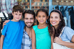 Portrait of a happy family having fun in the mall Stock Photo