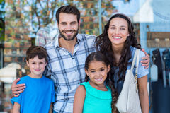 Portrait of a happy family having fun in the mall Stock Images