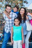 Portrait of a happy family having fun in the mall Stock Photos