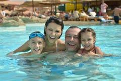 Family having fun in pool. Portrait of a happy family having fun in pool Royalty Free Stock Photo