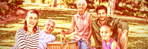 Portrait of happy family having picnic in the park stock photos