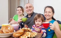 Portrait of  happy family having tea Stock Photography