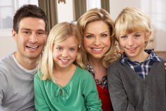 Portrait Of Happy Family At Home. Smiling royalty free stock photo