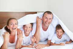 Portrait of happy family in home Stock Photography