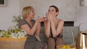 Portrait of a happy family at home, mother with daughter send a kiss.Slow motion