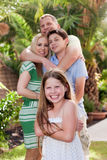 Portrait of happy family hugging each other Stock Photos