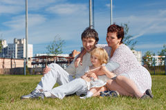 Portrait of a happy family. Portrait of a happy family at lawn Stock Photography