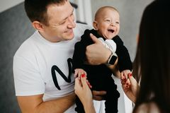 Portrait of a happy family with a little baby boy stock photography