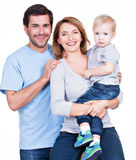 Portrait of the happy family with little child. Stock Photos